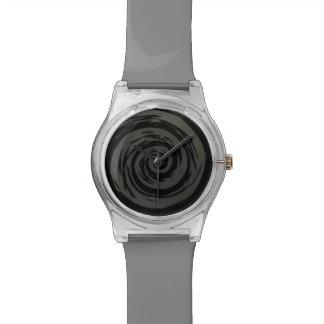 Arte hipnótico gris y negro del remolino reloj