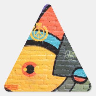 Arte-Pintada urbana de la calle Pegatina Triangular