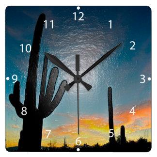Arte plástico 3d de la puesta del sol del cactus reloj cuadrado