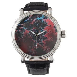 Arte rojo y azul de la danza del diablo - del reloj de mano