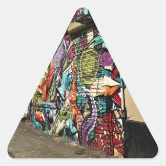 Arte urbano de la calle pegatina triangular