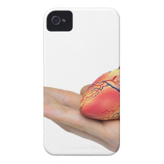 Artificial human heart model on hand iPhone 4 case