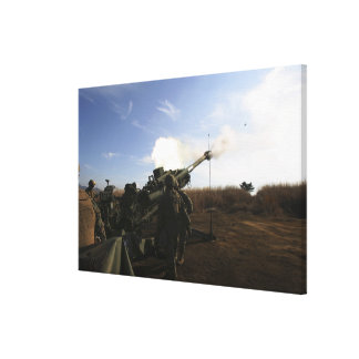 Artillerymen fire a 155mm round gallery wrap canvas
