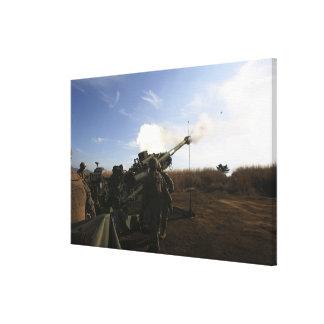 Artillerymen fire a 155mm round canvas print