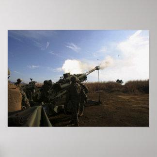 Artillerymen fire a 155mm round poster