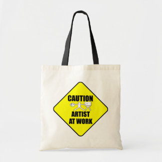 artist at work sign tote bags