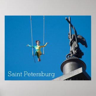 Artista aéreo que mira el ángel de bronce póster