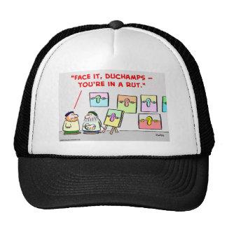 artista en una rodera gorras