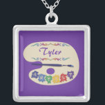 """Artists Palette Pendant<br><div class=""""desc"""">Colorful, customizable Artists Palette Name Pendant. This design has an artist's palette and brush, and the word &quot;artist&quot; is made to look like colorful paint splatters. You can personalize the artists name in our easy to use template. For further modifications on this name pendant, such as to change the background...</div>"""