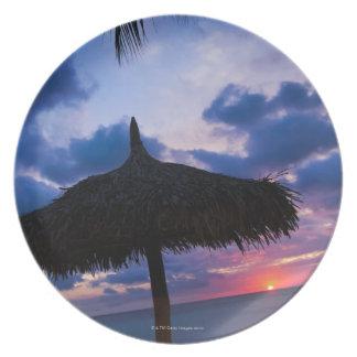 Aruba, silhouette of palapa on beach at sunset 2 melamine plate