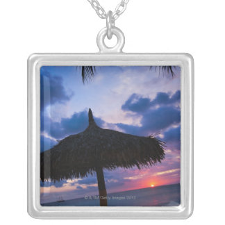 Aruba, silhouette of palapa on beach at sunset 2 silver plated necklace
