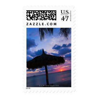 Aruba, silhouette of palapa on beach at sunset 2 stamp