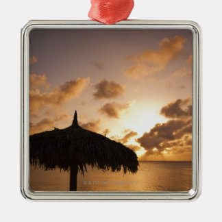 Aruba, silhouette of palapa on beach at sunset square metal christmas ornament