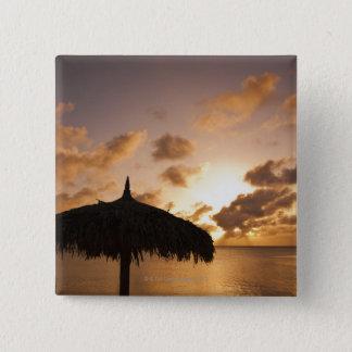 Aruba, silhouette of palapa on beach at sunset pinback button