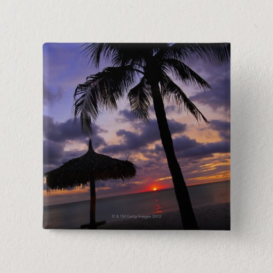 Aruba, silhouette of palm tree and palapa on button