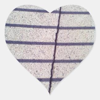 Asfalto y sombra pegatina en forma de corazón