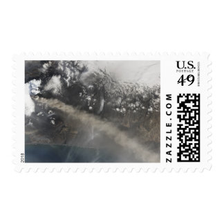 Ash and steam continue billowing postage stamp