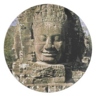 Asia, Cambodia, Siem Reap. Angkor Thom, heads of Melamine Plate