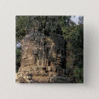 Asia, Cambodia, Siem Reap. Huge stone sculptures Button