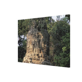 Asia, Cambodia, Siem Reap. Huge stone sculptures Canvas Print