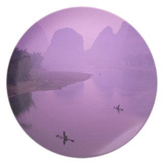 Asia, China, Guanxi, Yangshou. Fishermen on raft Party Plate