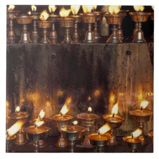 Asia, China, Tibet, Lhasa. Prayer flames, Tile