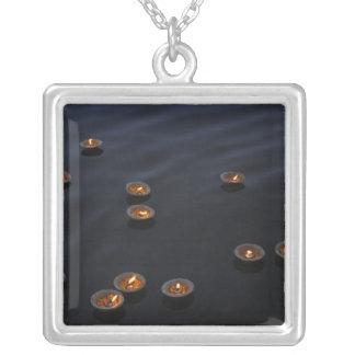 Asia, India, Varanasi Region. Offerings in the Square Pendant Necklace