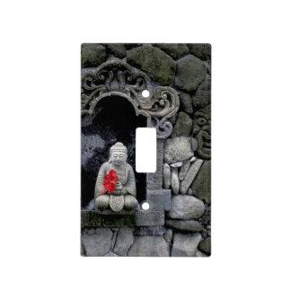 Asia, Indonesia, Bali. A shrine of Buddha Light Switch Cover