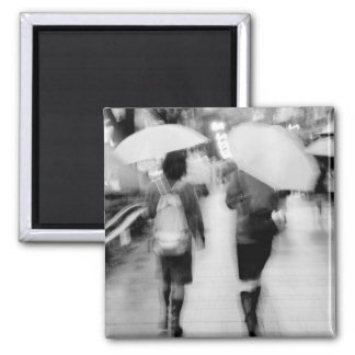 Asia, Japan, Tokyo. Young women and umbrellas. Magnet