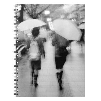 Asia, Japan, Tokyo. Young women and umbrellas. Notebook