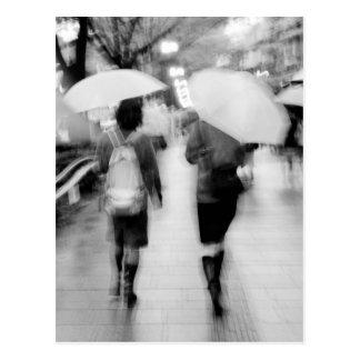 Asia, Japan, Tokyo. Young women and umbrellas. Postcard