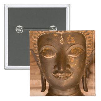Asia, Laos, Vientiane, Bronze sculpture at Wat Pinback Button