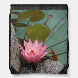 Asia, Vietnam. Water lily in a temple pond Drawstring Backpack