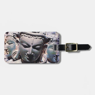 Asian antique, carved stone faces close-up photo bag tag