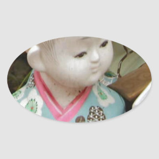 Asian ceramics, figure of a baby oval sticker