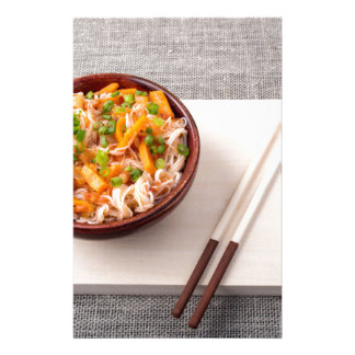 Asian dish of rice noodle and vegetable seasonings stationery
