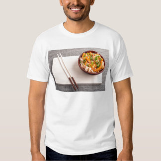 Asian dish of rice noodle in a small wooden bowl shirt