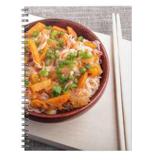 Asian dish of rice noodles in a small wooden bowl notebook