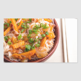 Asian dish of rice noodles in a small wooden bowl rectangular sticker