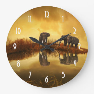 Asian Elephants in Thailand under a glowing sunset Clock