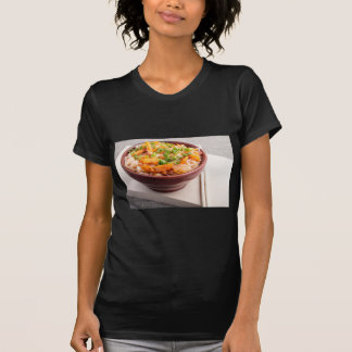 Asian food of rice noodles in a small wooden bowl dresses