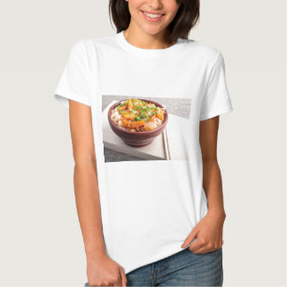 Asian food of rice noodles in a small wooden bowl shirt