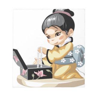 Asian girl in a yellow kimono memo pad
