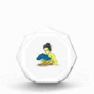 asian lady tending bonsai tree bluish.png award