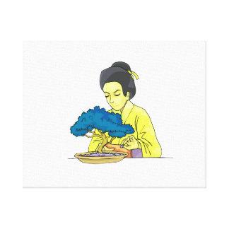 asian lady tending bonsai tree bluish.png canvas print