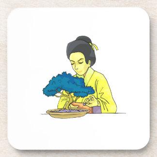 asian lady tending bonsai tree bluish png beverage coasters
