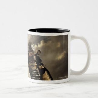 Asian man wearing samurai armor and holding Two-Tone coffee mug