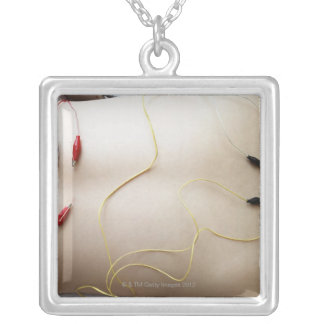 Asian woman (35-40 years old) lying on her silver plated necklace