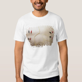 Asian woman (35-40 years old) lying on her t shirt