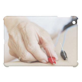Asian woman (70-75 years old) putting red and case for the iPad mini